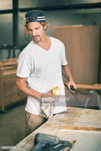 Carpenter working at workshop