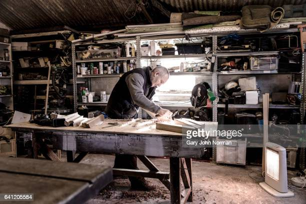 carpenter working in his workshop, wide shot - hobbies stock pictures, royalty-free photos & images