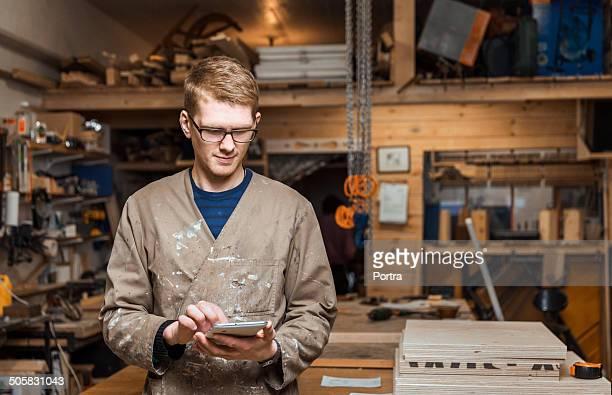 Carpenter working on his digital tablet.
