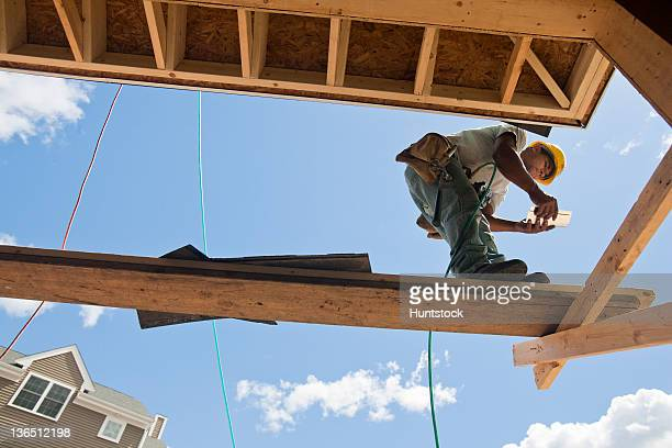Carpenter working on scaffold