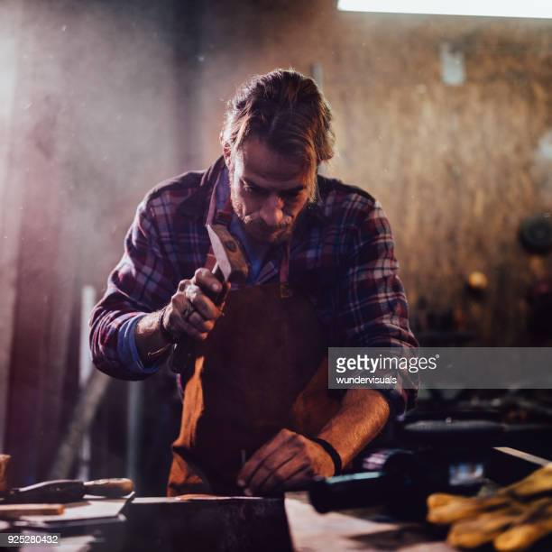 carpenter working with hammer and nails in workshop - hammer stock pictures, royalty-free photos & images