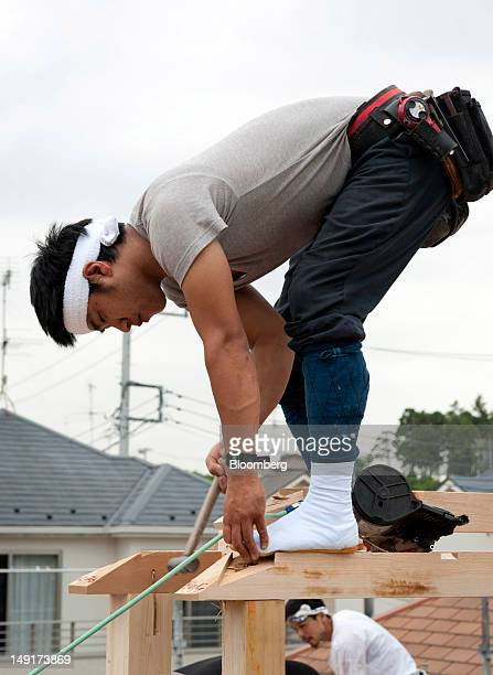 A carpenter works at a new home construction site in Yokohama Japan on Monday July 23 2012 Japan's new housing starts last year rose 26 percent to...