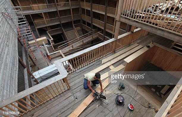 A carpenter works inside the 150 metrelong Noah's ark created by Dutch Johan Huibers at an old abandoned quay on the Merwede River in Dordrecht on...