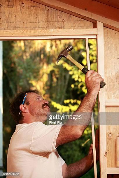 Carpenter works on Outdoor Shed