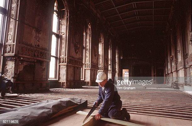 Carpenter Works On The Flooring Of Stgeorges Hall Windsor Castle During The Restoration Following The Disastrous Fire Of November 1992