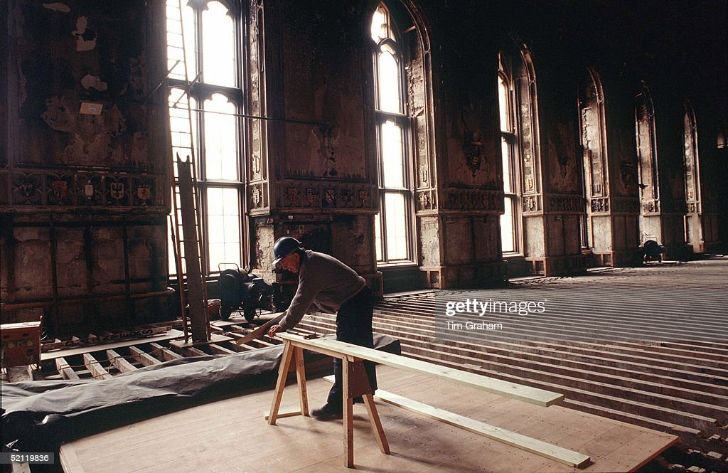 A Carpenter Works On The Flooring Of St.georges Hall Windsor Castle During The Restoration Following The Disastrous Fire Of November 1992.