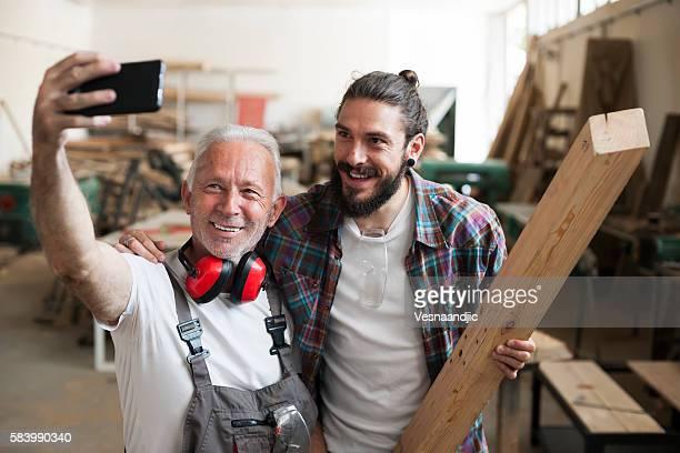 Carpenter's at work making selfie