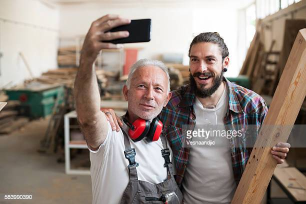 Carpenter's at work making selfie