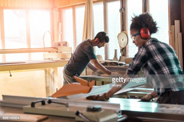 carpenters at work - circular saw stock photos and pictures