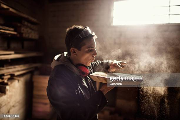 carpenters at work - craftsman stock photos and pictures