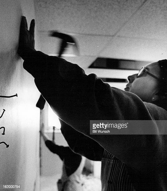 APR 1975 APR 18 1975 Carpenters Dorothy Hamilton helps put use drywall The four bent nails represent her four trys on what she said must be concrete