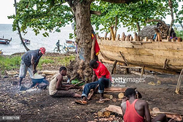 Carpenters make a wooden boat in Mkokotoni village Zanzibar Tanzania