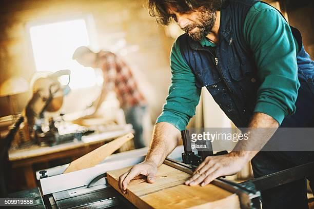 Carpenters making furniture.