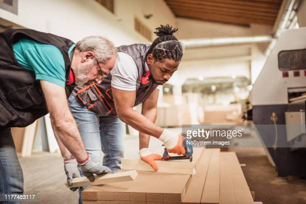 carpenters - african american man helping elderly stock pictures, royalty-free photos & images