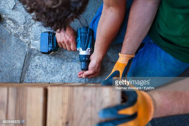 carpenters working together while making furniture - foundation make up stock pictures, royalty-free photos & images