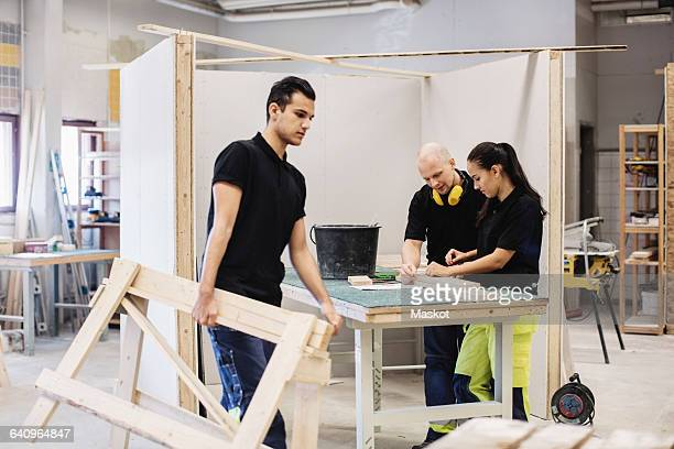 Carpentry students and teacher working at class