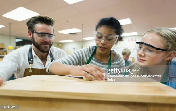 Carpentry teacher and students in workshop