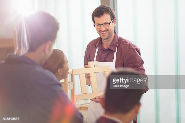 Carpentry teacher leading lesson in workshop