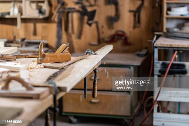 carpentry with tools and wood workpieces - carving craft product stock pictures, royalty-free photos & images