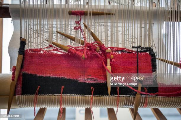 carpet being woven on an old wood loom - hainaut stock pictures, royalty-free photos & images