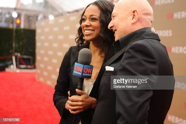 Carpet hostess Nischelle Turner and 2011 honoree Bruno Serato attend the CNN Heroes An All Star Tribute at The Shrine Auditorium on December 2 2012...