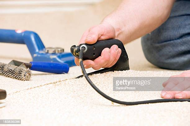 Carpet Installer Joining Two Pieces with Seam Iron