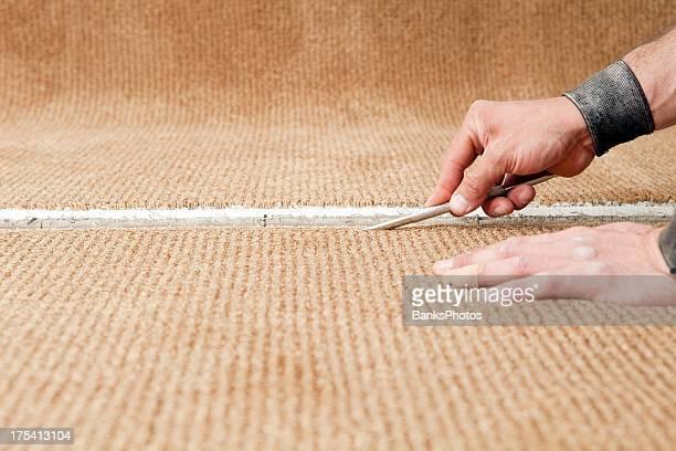 Carpet Installer Using Row Finder