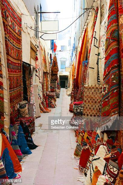 carpet lane in the souk market essaouira,morocco,africa - rabat morocco stock pictures, royalty-free photos & images
