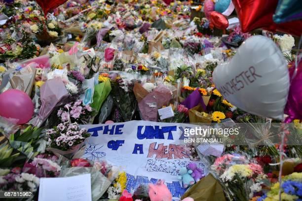 Carpet of flowers and messages lie at St Ann's Square in Manchester, northwest England on May 24 placed in tribute to the victims of the May 22...