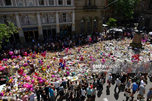 A carpet of messages of support and floral tributes to the victims of the Manchester attack lies in St Ann's Square in Manchester on May 27 2017...