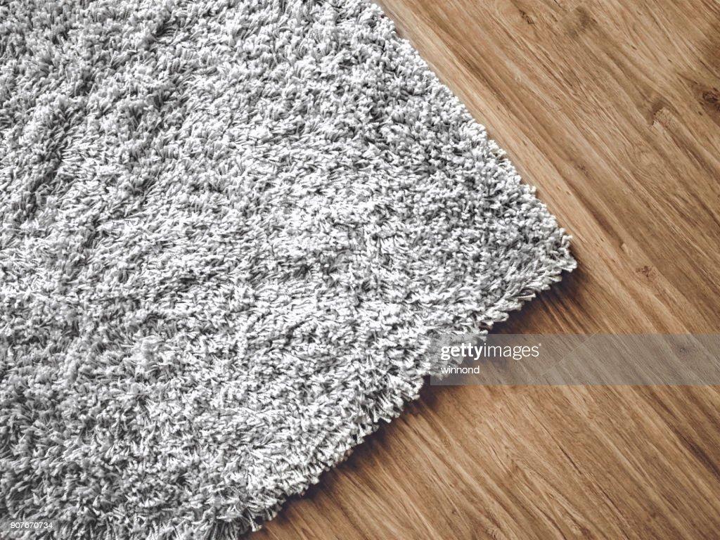carpet on parquet : Stock Photo