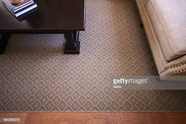 Carpet over wooden floor