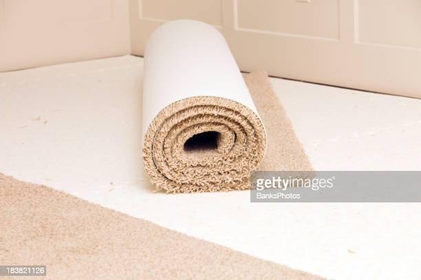 Carpet Roll on Pad in Bedroom Awaiting Installation
