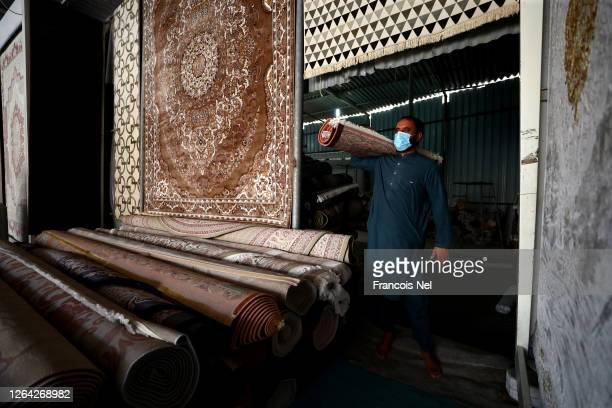 A carpet vendor arranges carpets on August 06 2020 in Fujairah United Arab Emirates The Coronavirus pandemic has spread to many countries across the...