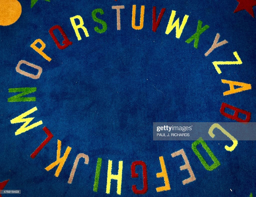 A carpet with the English alphabet is seen February 21, 2014, at Steuart W. Weller Elementary School in Ashburn, Virginia AFP PHOTO/Paul J. Richards