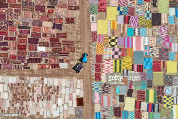 Carpets are seen drying in the sun on August 20, 2019 in Dosemealti, Turkey. Turkey is famous for its artisan carpets but before they are sent to...