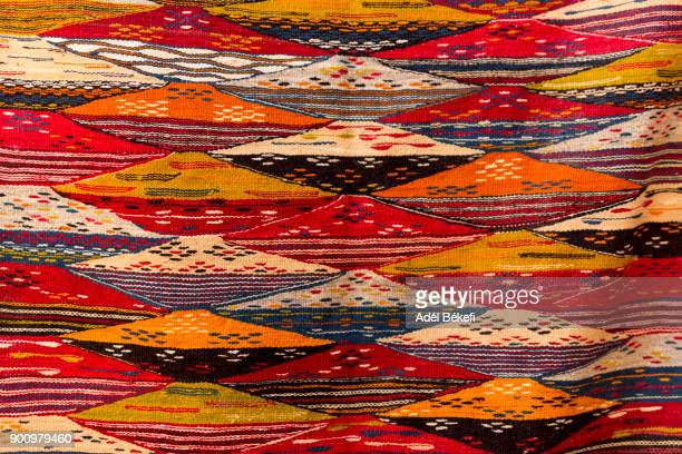 carpets for sale in carpet shop in the medina. (morocco) - textile industry stock pictures, royalty-free photos & images