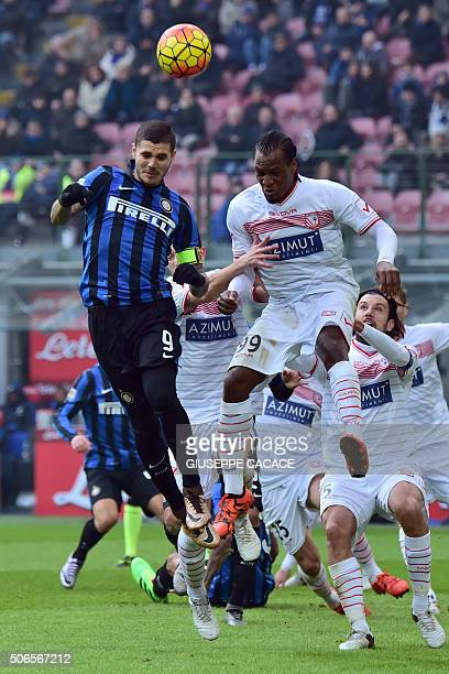 Carpi's forward from Nigeria Jerry Mbakogu fights for the ball with Inter Milan's forward from Argentina Mauro Icardi during the Italian Serie A...