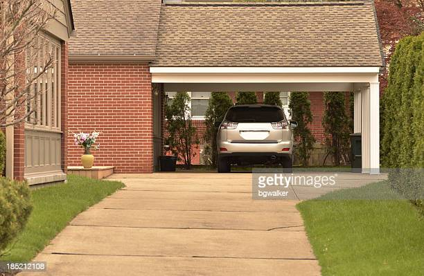carport with parked car and nicely maintained grounds - garage stock pictures, royalty-free photos & images