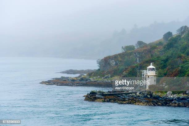 carraig mhor lighthouse, sound of islay near port askaig, argyll and bute, scotland, united kingdom, europe - alan copson stock pictures, royalty-free photos & images
