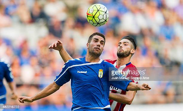 Carrasco ofÊClub Atletico de Madrid duels for the ball with Johannesson of Real Oviedo during a pre season friendly match between Real Oviedo and...