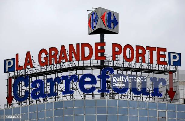 Carrefour logo sits on the facade of a Carrefour supermarket on January 14, 2021 in Paris, France. The Canadian distributor Couche-Tard, a specialist...