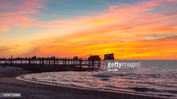 carrelet fishing huts on stilts at sunset near la rochelle france - la rochelle stock pictures, royalty-free photos & images