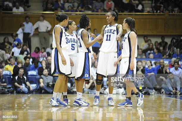 Carrem Gay Jasmine Thomas Keturah Jackson Chante Black and Abby Waner of the Duke Blue Devils huddle up during the game against the Maryland...