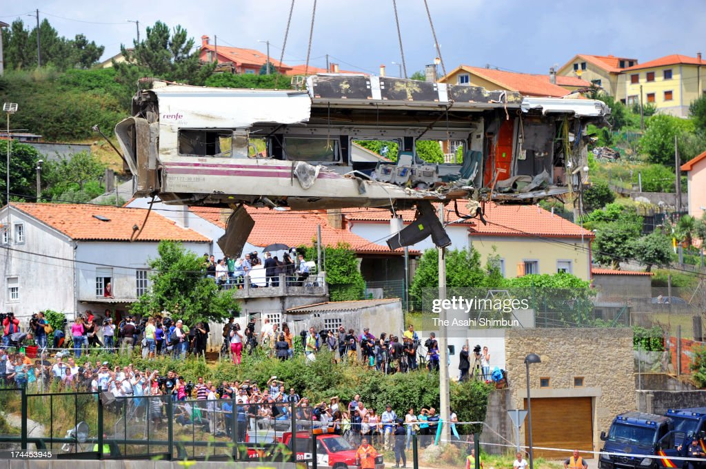 A carriage of a crashed train that killed 80 people is lifted on July 25, 2013 at Angrois near Santiago de Compostela, Spain. The crash occurred on Wednesday at 8.40pm as the train approached the north-western Spanish city of Santiago de Compostela, with 247 passengers on board.