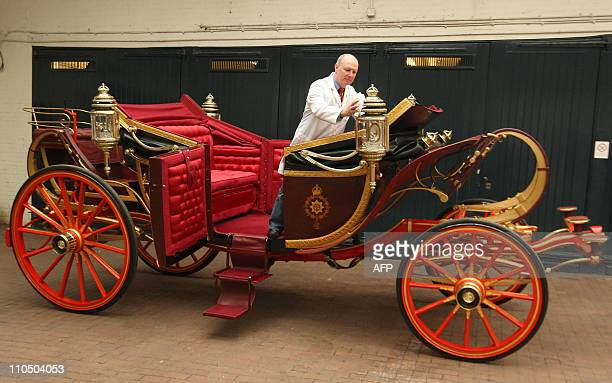 Carriage Restorer Dave Evans cleans the 1902 State Landau carriage at the Royal Mews in central London on March 21 2011 The coach will be used to...