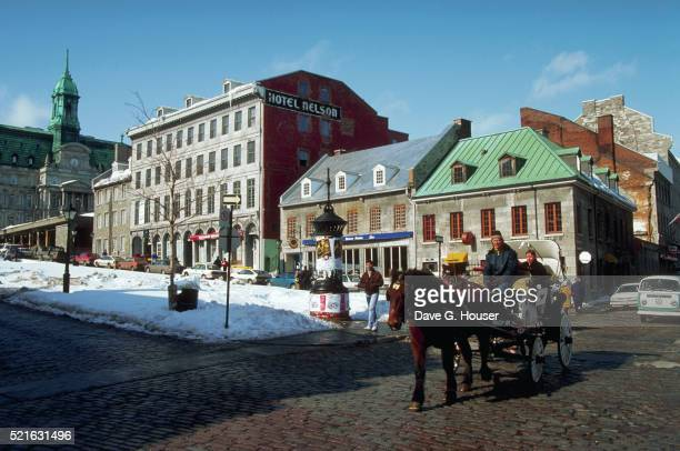 carriage ride in snowy montreal square - place jacques cartier stock pictures, royalty-free photos & images