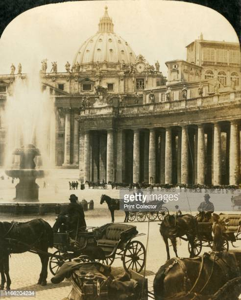 """Carriages by the fountain in St Peter's Square, Rome, Italy, circa 1909. One of a set of stereocard views by George Rose, boxed as """"Studies through..."""