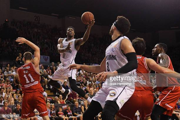 Carrick Felix of Melbourne lays up a shot under pressure during the round 13 NBL match between the Illawarra Hawks and Melbourne United at Wollongong...