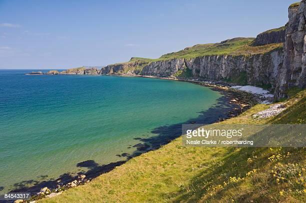 Carrick Island in Larrybane Bay, with a limestone headland, on the North Antrim Causeway Coast Way, County Antrim, Ulster, Northern Ireland, United Kingdom, Europe